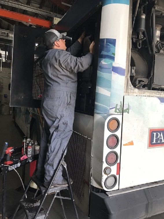 Mechanic working on bus