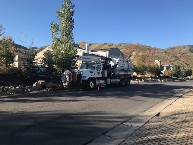 Vactor Truck parked on city street